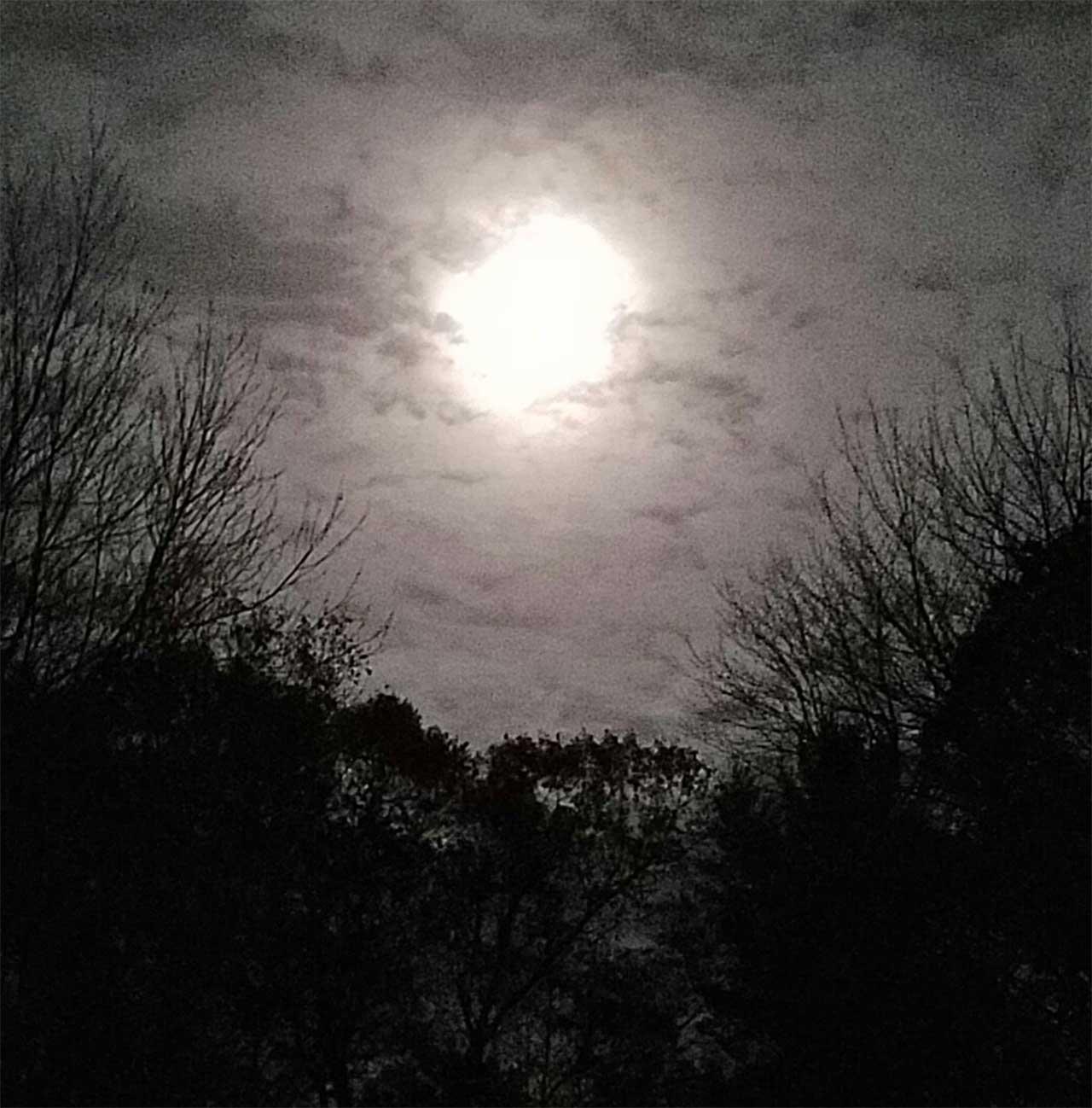 Super Moon through the clouds